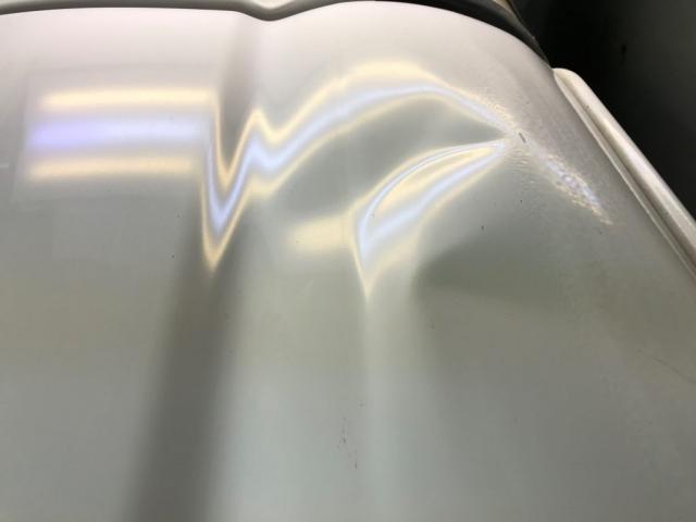 white car dent