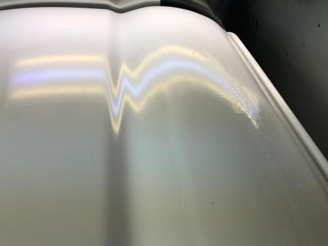 white car fixed dent